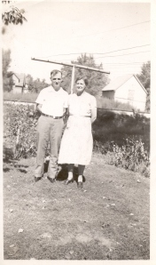 Dorothy's parents Edwin and Inger Peterson in the backyard of 2030 Helena, ca. 1920. Note railroad tracks in background.