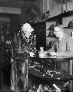 Salesman shows a Hankscraft egg cooker to a customer at Harloff-Loprich Electric Company, 506 State Street. December 1928. Angus McVicar photo Whi-21460  courtesy of Wisconsin Historical Society.