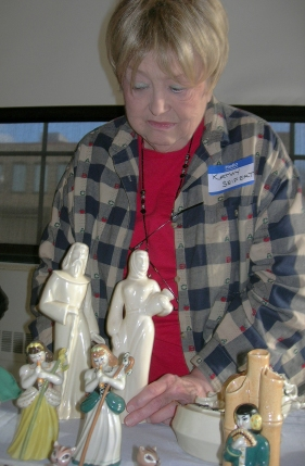 "Kathy Siefert displays her Ceramic Arts Studio figurines known as ""Rebecca and Isaac""."