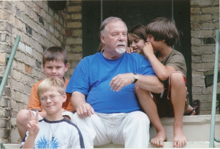 """Grandpa Ron"" with grandchildren Kale, Finn, Evelyn, and August."