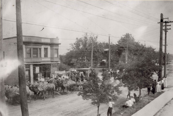 Circus parade passing Frederick and Mary Mark's confectionary. This view is north-northeast beyond the intersection of Williamson and Dickinson Streets ca. 1909. Courtesy of Wisconsin Historical Society, WHi- 3152