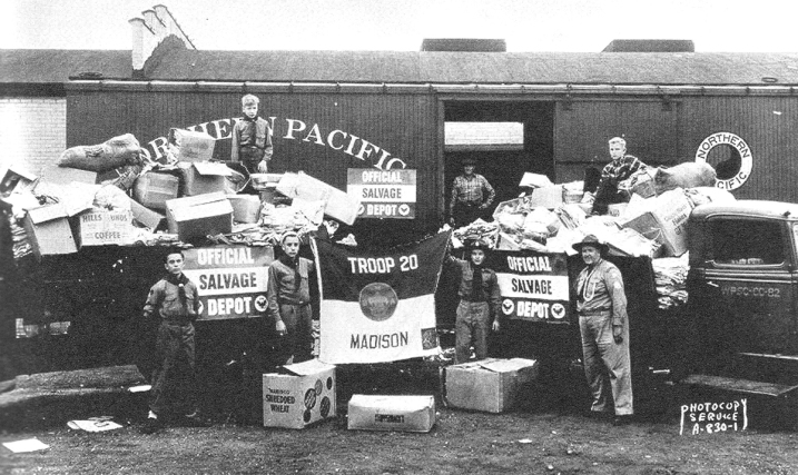 Clarence Beebe and Scouts from Troop 20 loading a railroad car as part of a World War II recycling effort. Photo taken from a history of the Four Lakes Council of Boy Scouts.