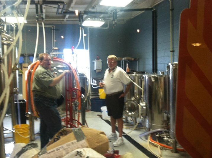 Brewer Keith Symones (left) shows his father Ken the new brew room.