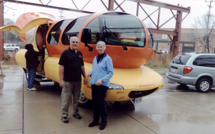 Dave Arndt and Sara Preez visit the Oscar Mayer Weinermobile.