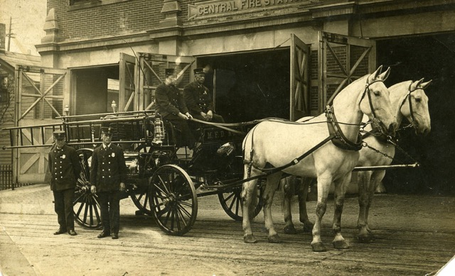 Brothers Elmer and George Beale, fire fighters  in front of fire station at 18 S. Webster Street, ca. 1910.