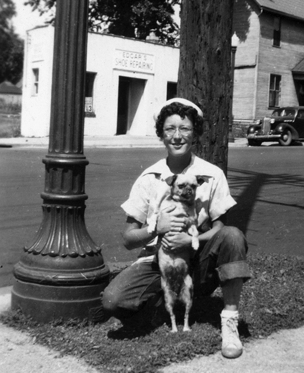1948: JoAnn Hoveland in front of Edgars Shoe Repair (by Alice Dill- man.)