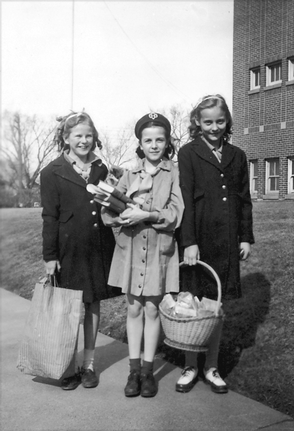 Girl Scouts deliver cookies, circa 1945: Elaine Tripalin in the center, with twins Janet, left, and Janice Irvin, right, in front of Lowell School. Photo courtesy of Catherine Tripalin Murray.