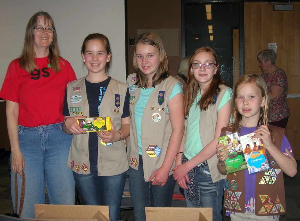 girl scouts with cookies