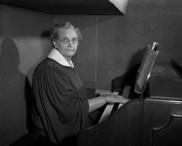 Mrs. James J. (Ida) Vanderhoef sits at the newly dedicated Joyce and Victor Glenn Memorial Organ at Bashford Methodist church located at the corner of North 7th Street and East Washington Avenue. WHS Image 62203, 11/3/1949, by Arthur Vinje.
